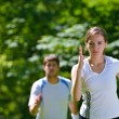 Young couple jogging at morning — Stock Photo #13213836
