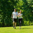Young couple jogging at morning — Stock Photo #13213848