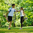 Couple doing stretching exercise  after jogging — Стоковая фотография