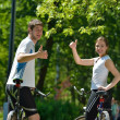 Happy couple riding bicycle outdoors — Stock Photo