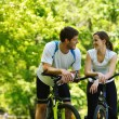 Happy couple riding bicycle outdoors — Stock Photo #13214131
