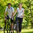 Happy couple riding bicycle outdoors — Stock Photo #13214185