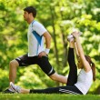 Couple doing stretching exercise after jogging — Stock Photo #13214349