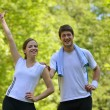 Couple doing stretching exercise  after jogging — Stockfoto