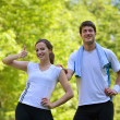 Couple doing stretching exercise after jogging — Stock Photo #13214498