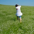 Young happy woman in green field — Photo