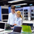 Buy  in consumer electronics store - Foto Stock
