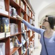 Female in library — Stock Photo