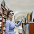 Female in library — Foto de Stock