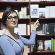 Female in library -  