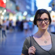 Woman portrait at night in city — Stock Photo #13269697