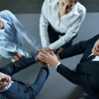 Business group joining hands — Stock Photo #13269843