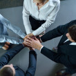 Business group joining hands — Stock Photo #13269846