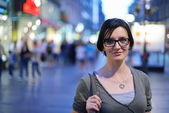 Woman portrait at night in city — Stock Photo