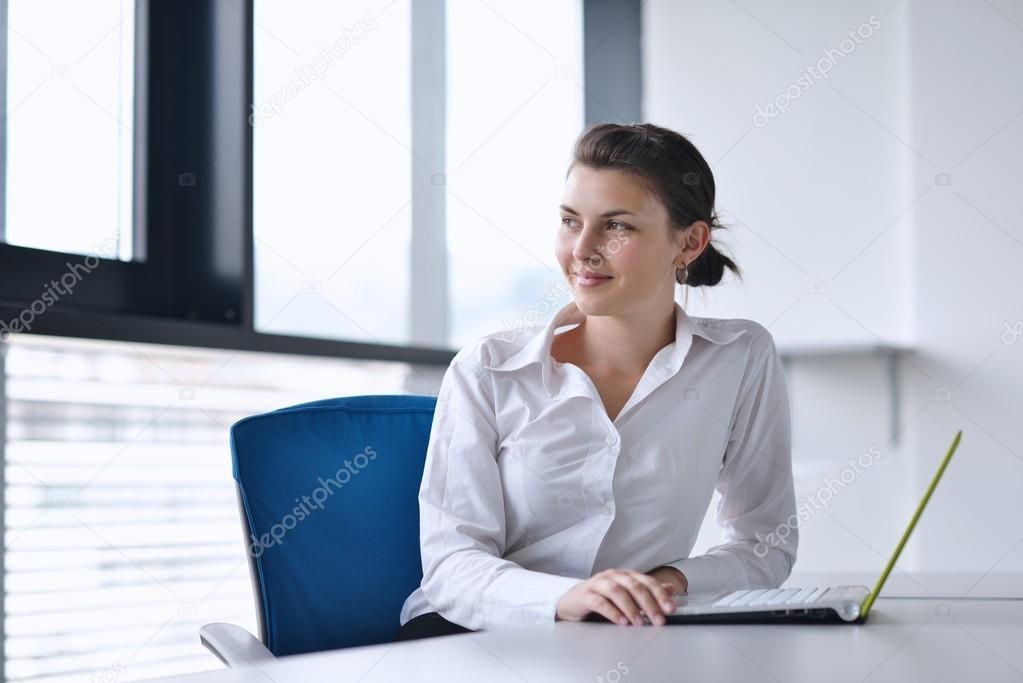 Young pretty business woman with notebook in the bright modern office indoors — Stock Photo #13269914