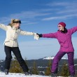 Winter season fun with group of girls — Stock Photo