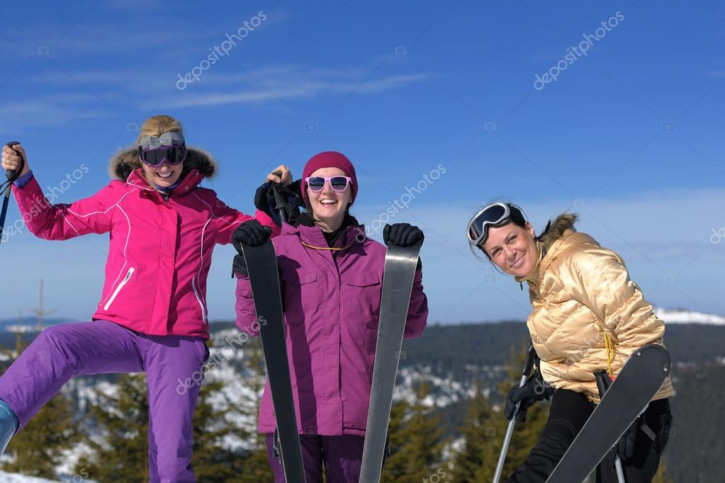 Happy friends group of woman girls have fun at winter season at beautiful sunny  snow day with blue sky in background — Stock Photo #13271212