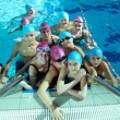 Happy childrens at swimming pool - Stock Photo