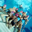 Happy childrens at swimming pool — Photo