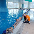Stock Photo: Happy childrens at swimming pool
