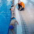 Happy childrens at swimming pool - Foto Stock