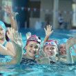Happy childrens at swimming pool — Stock Photo