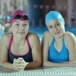 Happy childrens at swimming pool - Stok fotoğraf