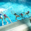 Happy childrens at swimming pool — Stock Photo #14063298