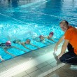 Постер, плакат: Happy childrens at swimming pool