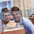 Happy young couple in jewelry store - Stock Photo