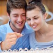 Happy young couple in jewelry store - Stockfoto