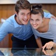 Happy young couple in jewelry store — Stock Photo