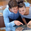 Happy young couple in jewelry store — Stock Photo #14064724