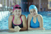 Happy childrens at swimming pool — Stok fotoğraf