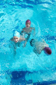 Happy childrens at swimming pool — ストック写真