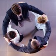 Stock Photo: Business group joining hands