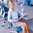 Business woman with her staff in background at office — Foto de Stock