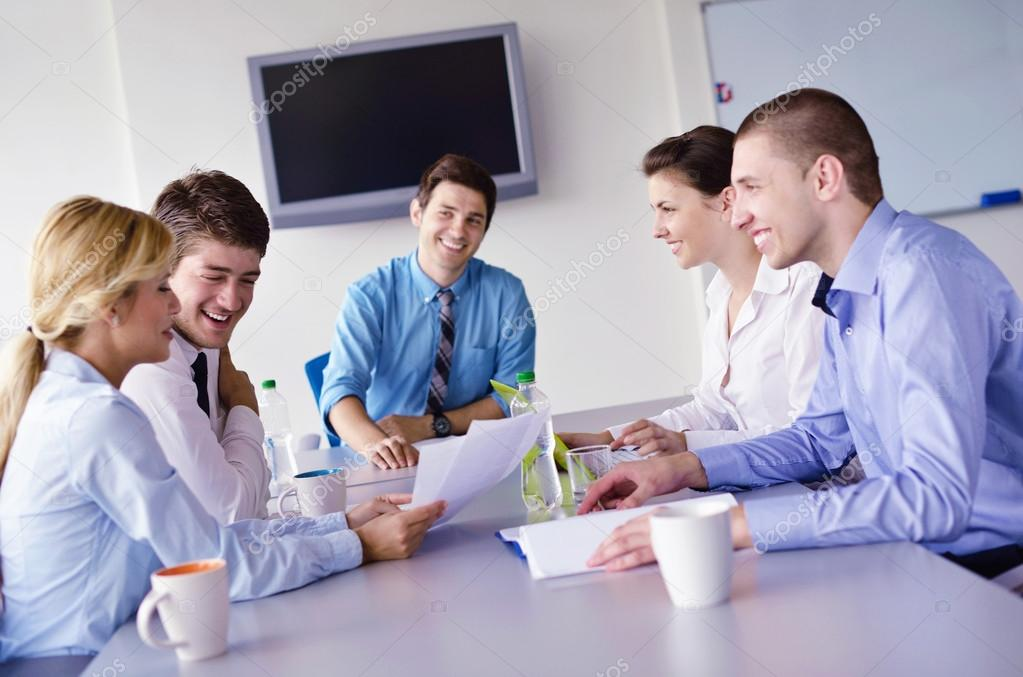 Group of happy young  business in a meeting at office  Stock Photo #14450785