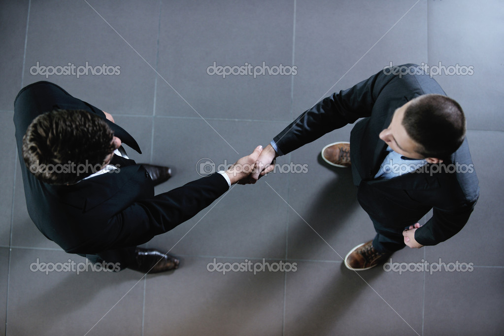 Business shaking hands make deal and sign contract  Stock Photo #14499375