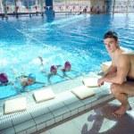 Happy child on swimming pool — Stock Photo