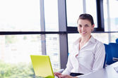 Young pretty business woman with notebook in the office — Stock Photo