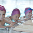 Happy children group at swimming pool — Stock Photo #16193133