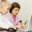 Children playing games on laptop — Stock Photo #1673402