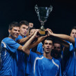 Soccer players celebrating victory - Stock Photo