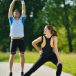 Doing stretching exercise after jogging — Stockfoto #16790157