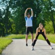 Doing stretching exercise  after jogging — Stock Photo