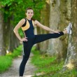 Woman stretching before fitness - Stockfoto