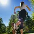 Young beautiful  woman jogging at morning in park — Lizenzfreies Foto