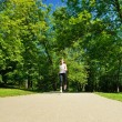 Young beautiful woman jogging at morning in park — Stock Photo