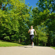 Young beautiful  woman jogging at morning in park - Foto de Stock